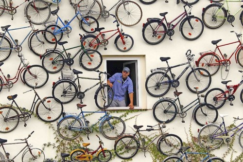 Co-owner Christian Petersen looks out of a window as he poses for the media at his bicycle shop in Altlandsberg