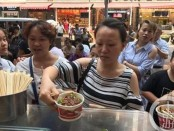 treats thousands to free meal
